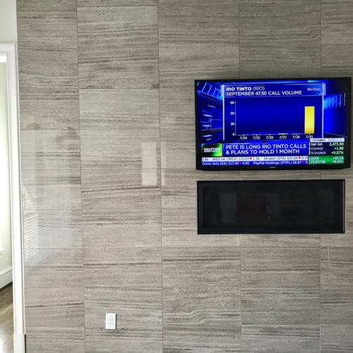 A Dallas TX home theater setup, featuring a TV, installed and mounted by 7pixl